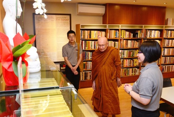 Sis. Nandini leading Ajahn Tiradhammo on a building tour.