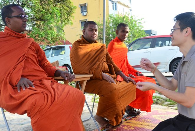 Bro. Choong Li engaging with the three venerable monks invited to go on alms-round.