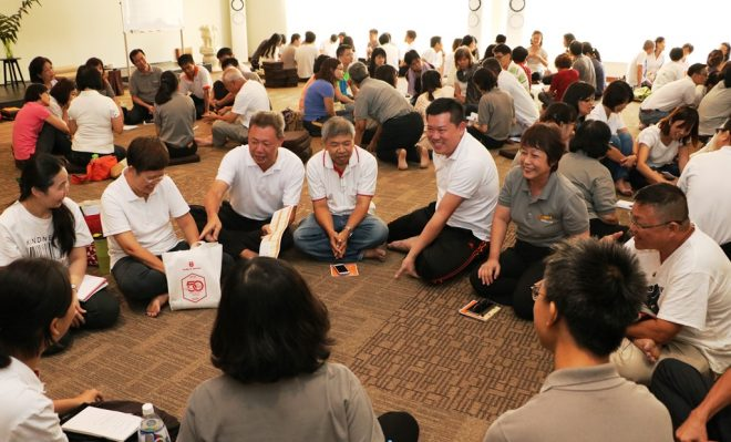 Devotees enjoying group discussion and dynamic learning last year.