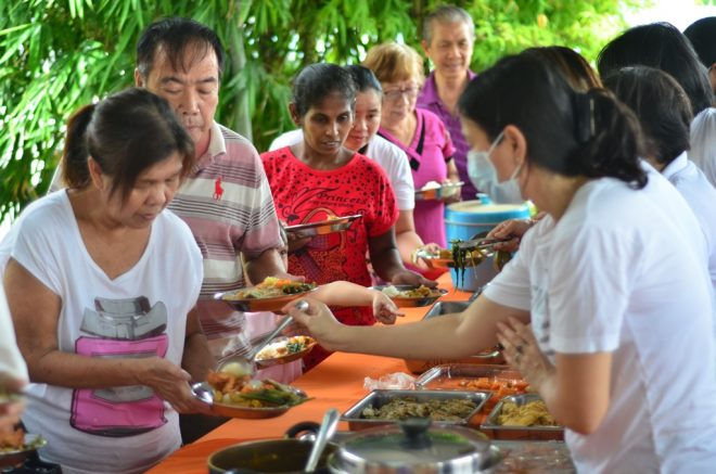 Generous devotees offering free food to the public on Wesak Day.