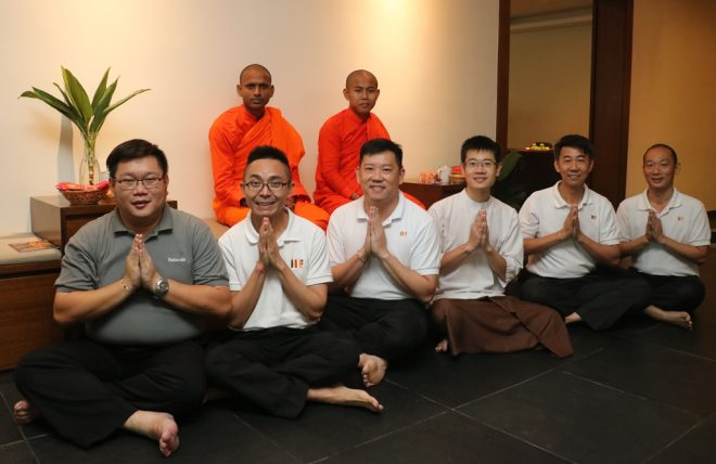 The hosting team posing with Venerable Bhikkhu Sudhamma (left) and Samanera Sumana.
