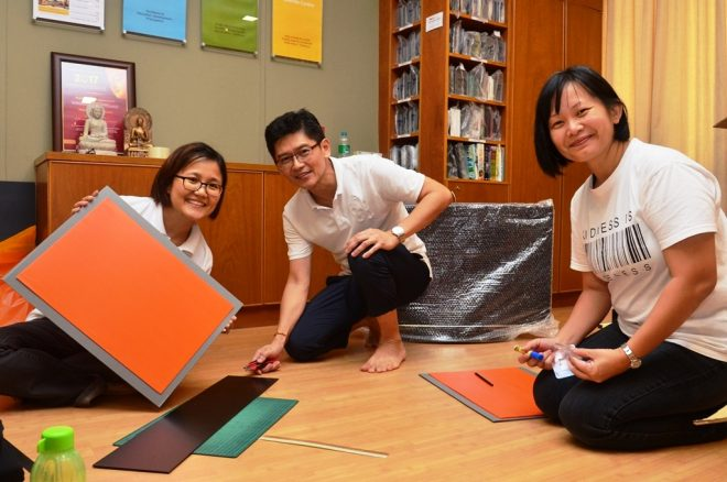 The exhibition team preparing materials for display on Conference day.