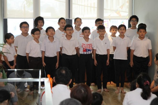 Nalanda Junior Dhamma School students performing Buddhist hymns.