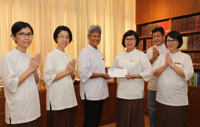 "President Sis. Evelyn handing over the ""Sri Lanka flood relief fund"" to TBCM."
