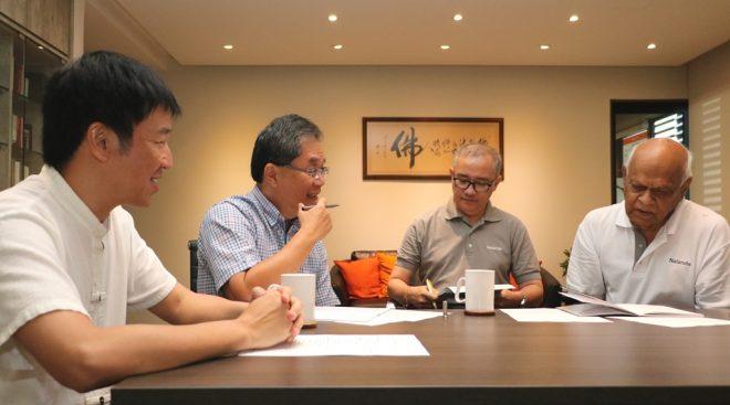 Tan Siang Chye (in light blue shirt) meeting with senior Nalanda education officers.