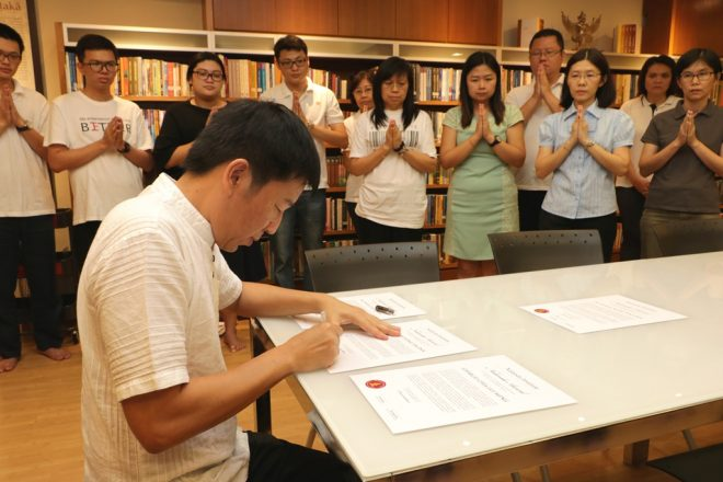Bro. Tan signing the certificates in his capacity as Director of Education
