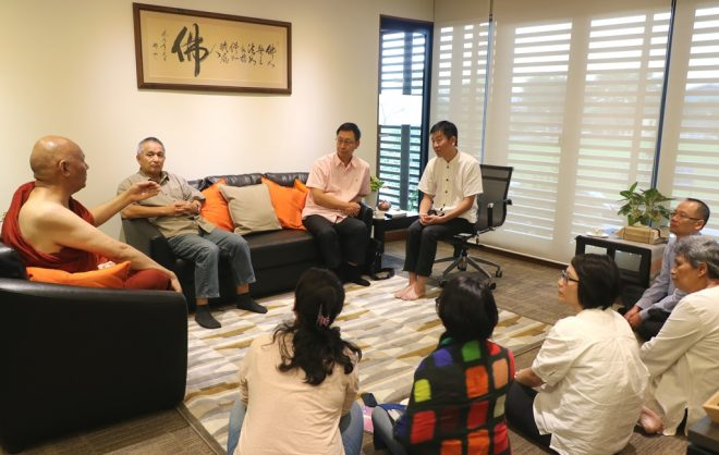 Ven. Sanghasena making a point at a meeting with Bro. Tan and Nalanda officers.