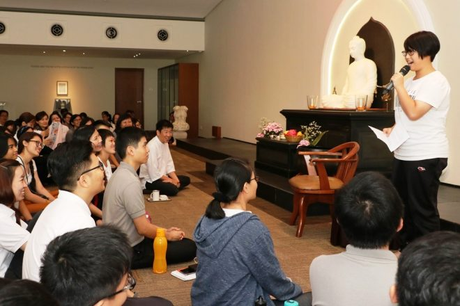Volunteers took turns to share their experience over Wesak.