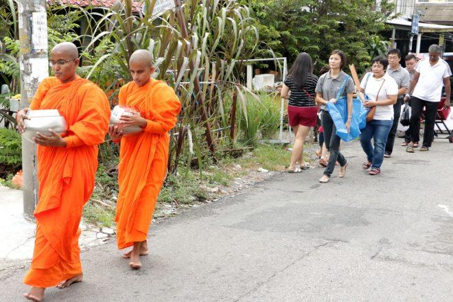 Nalanda volunteers walked behind the bhikkhunis at a respectful distance.