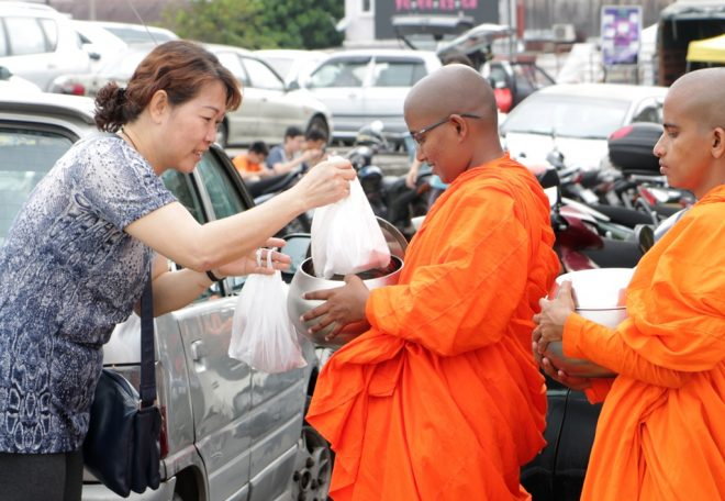 The two venerable Sri Lankan bhikkhunis went around mindfully collecting almsfood.